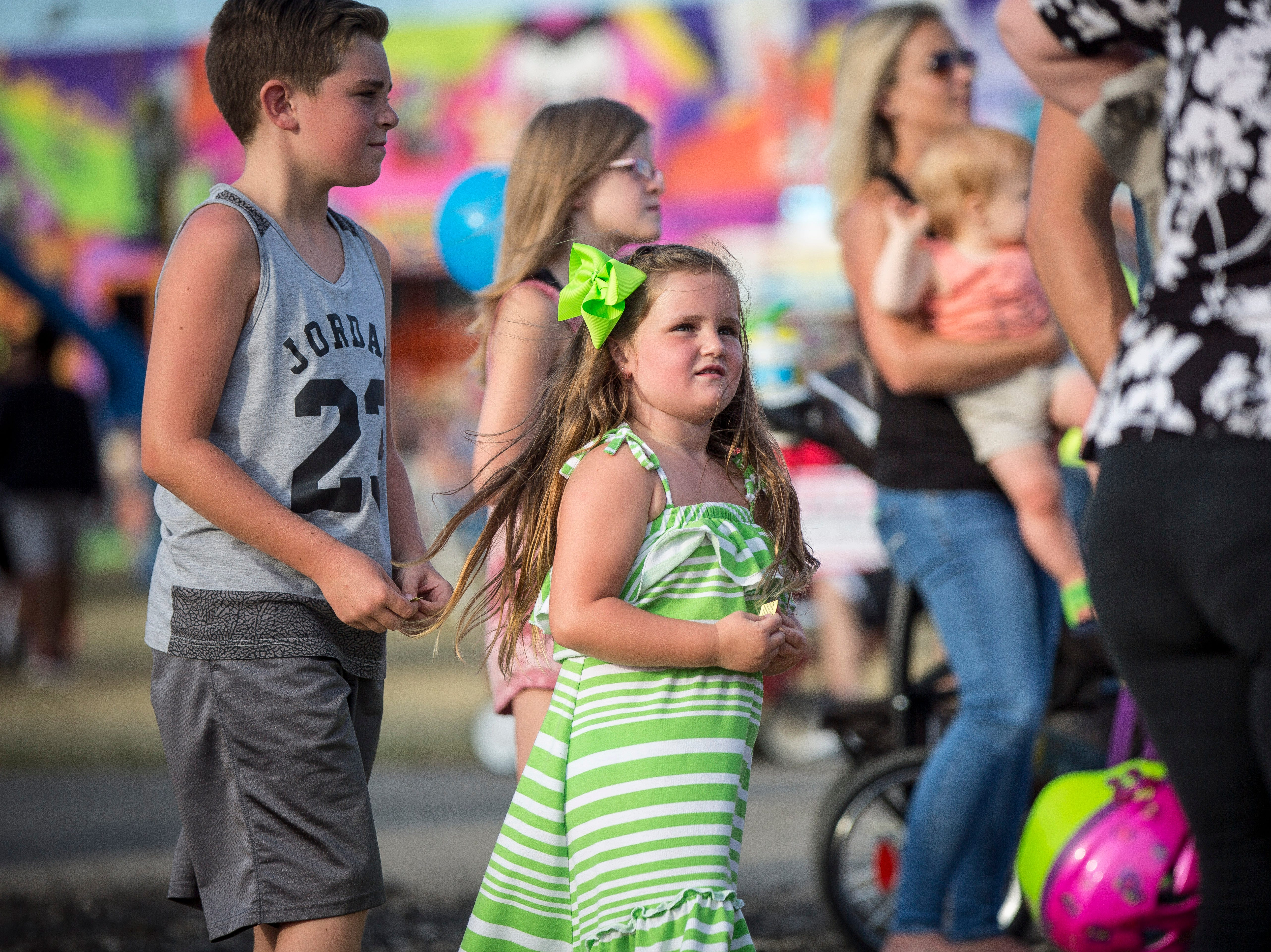 From baseball caps to overalls and cutoff jeans, there is a wide array of fashion at the Delaware County Fair.