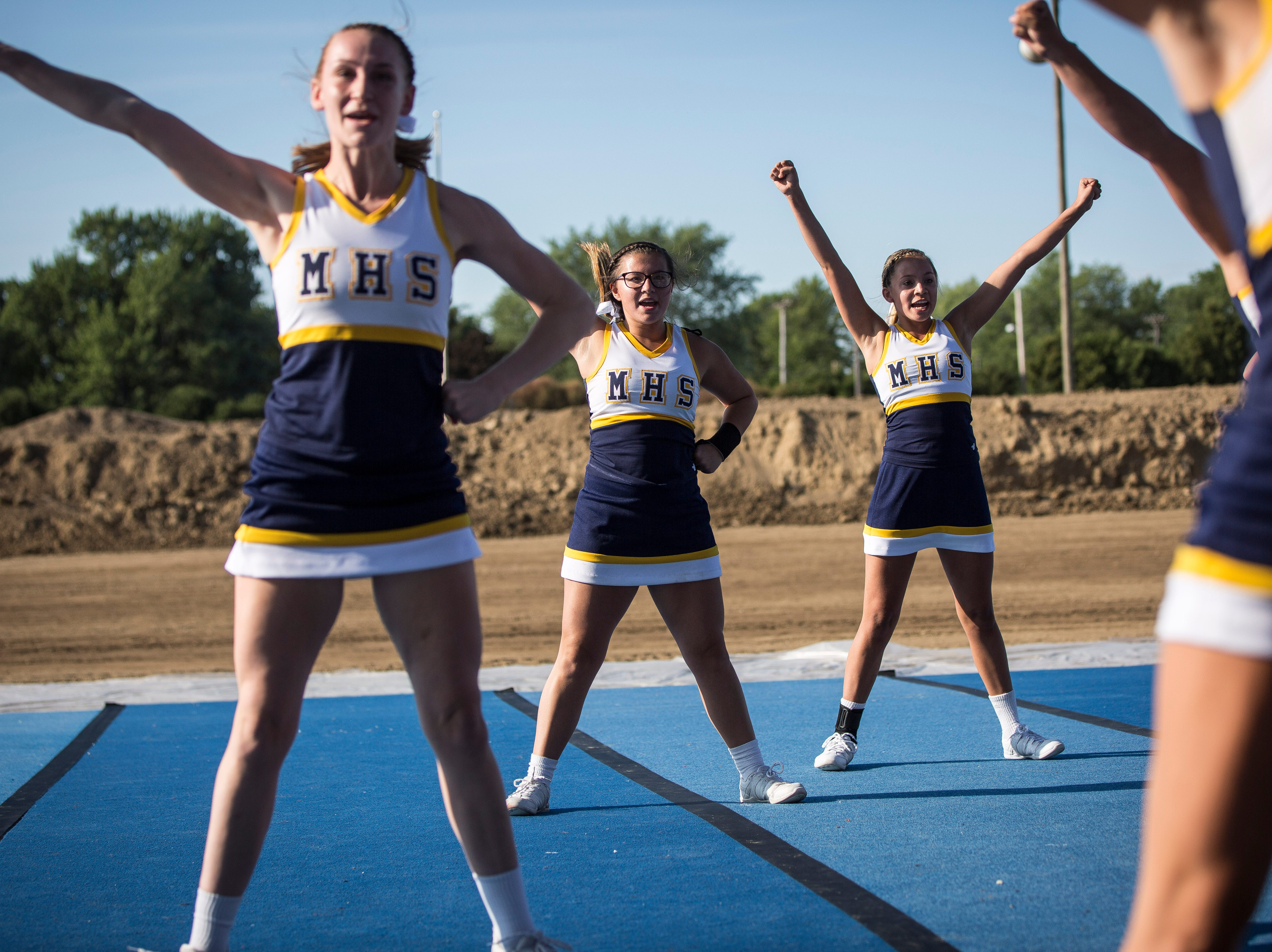 Cheerleaders from three different schools compete on Thursday at the Delaware County Fair cheerleading competition. The three schools competing were Daleville, Mooresville and Fall Creek