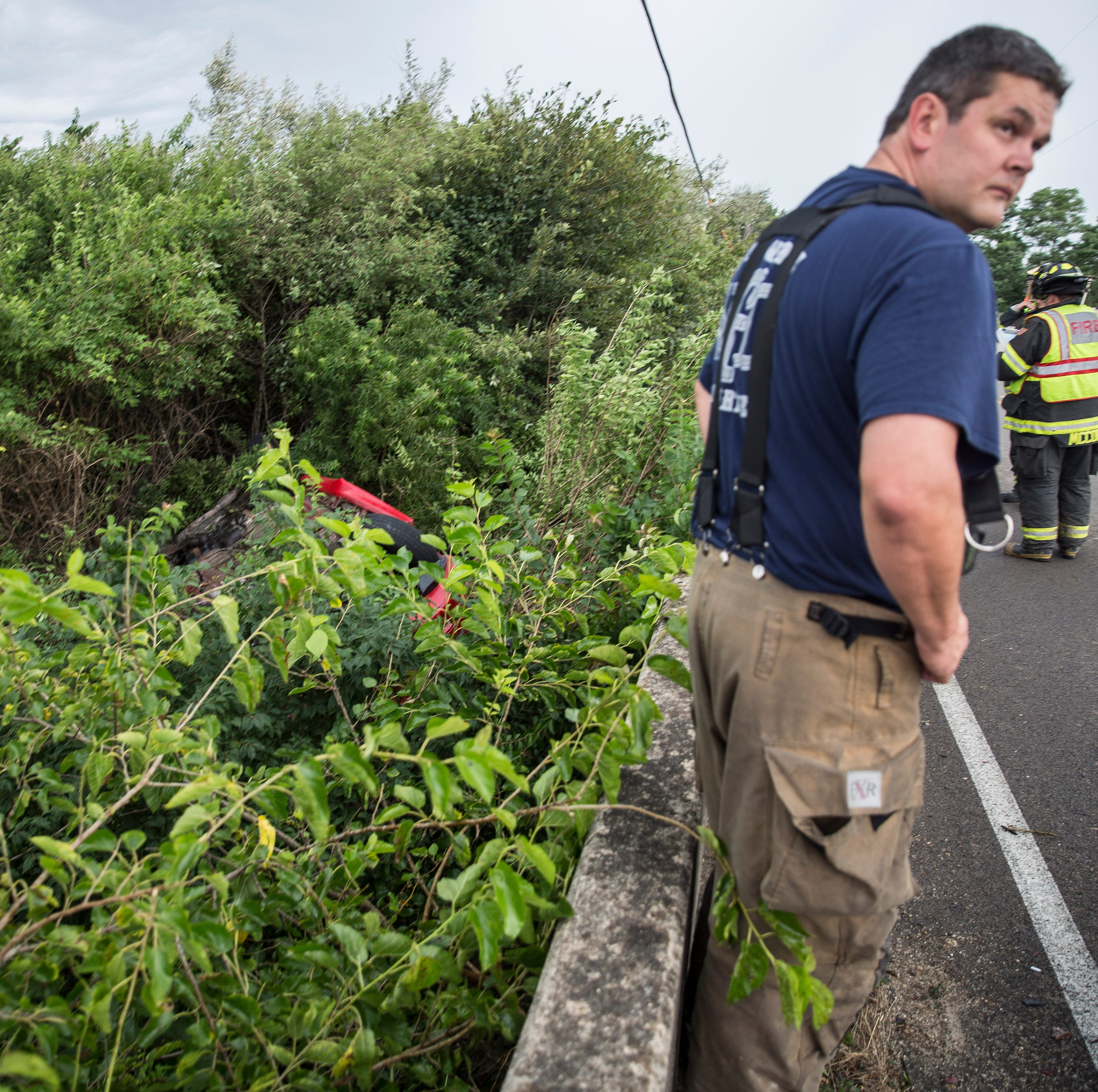 Car flips over bridge along Nebo Road, critically injures two