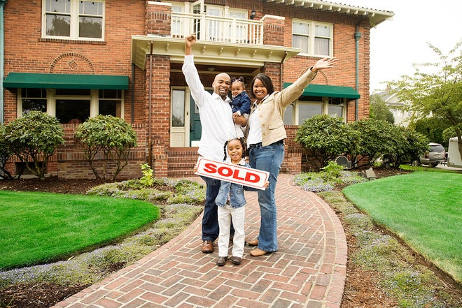 A family celebrating their new home.