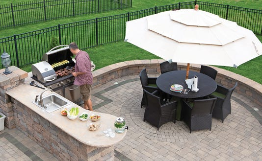 Man Cooking Meat On A Gas Bbq