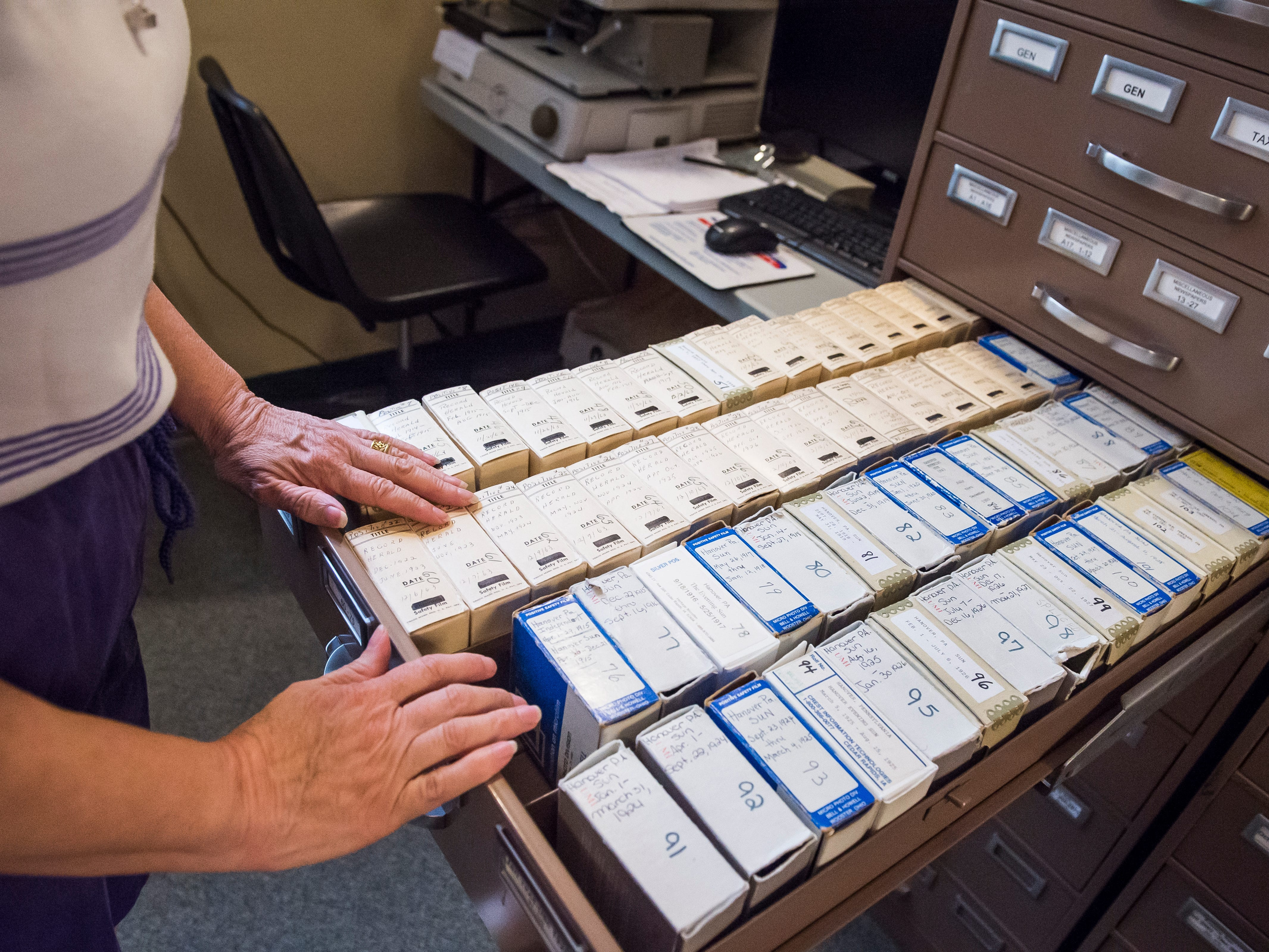 Wendy Bish-McGrew looks through a filing cabinet full of microfilm of Hanover newspapers going back as far as the 19th century at Guthrie Memorial Library.