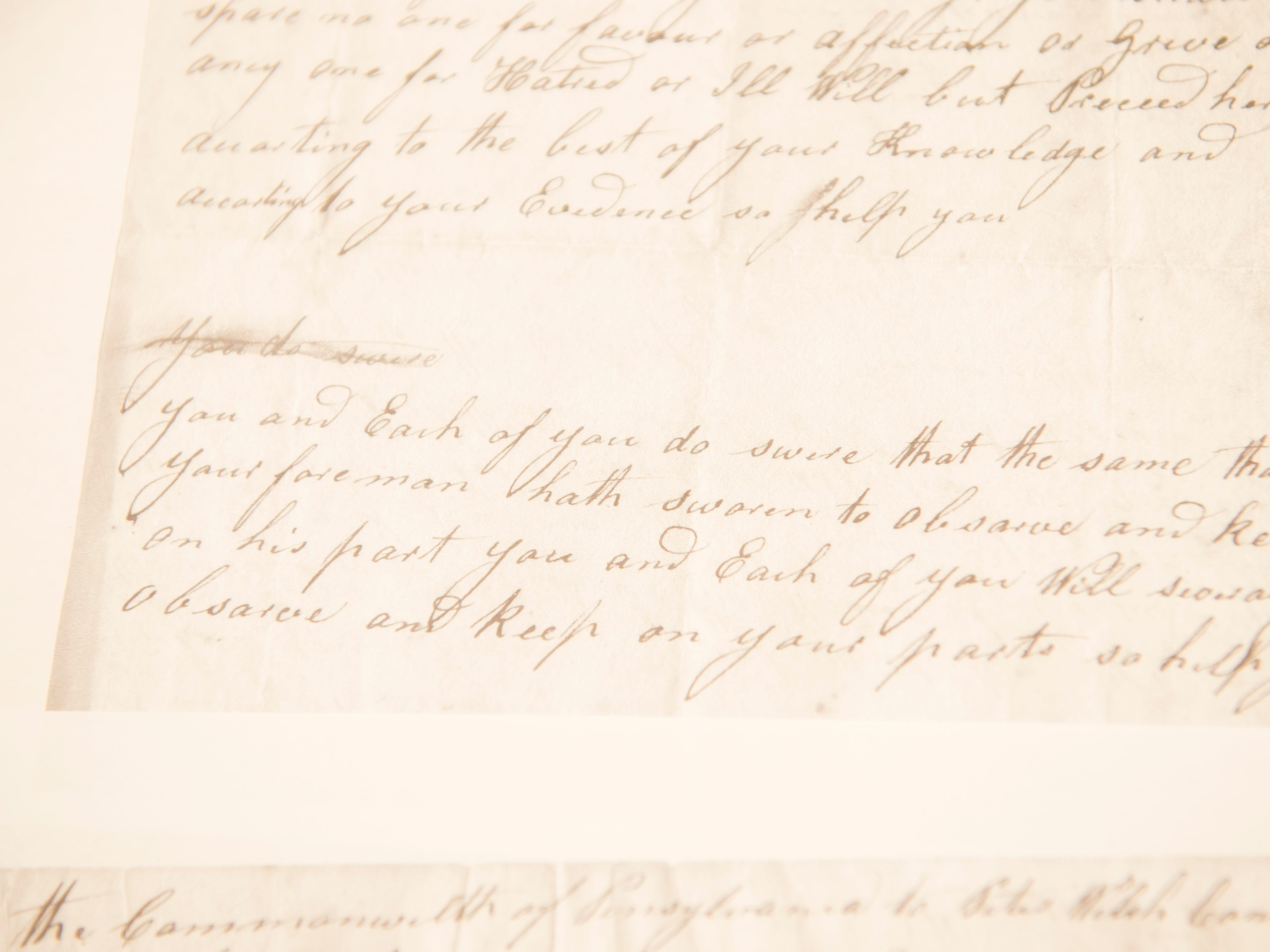 A copy of a court issued, hand-written subpoena for a Magdelinia Kitchen, one of four people who lived in a home on York Street where a girl's body was found in 1801. Kitchen was found not guilty.