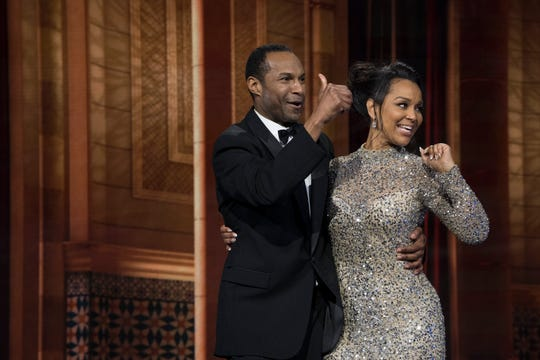 """LisaRaye McCoy and Anthony Bryant pose for pictures after getting engaged on ABC's """"The Proposal""""."""