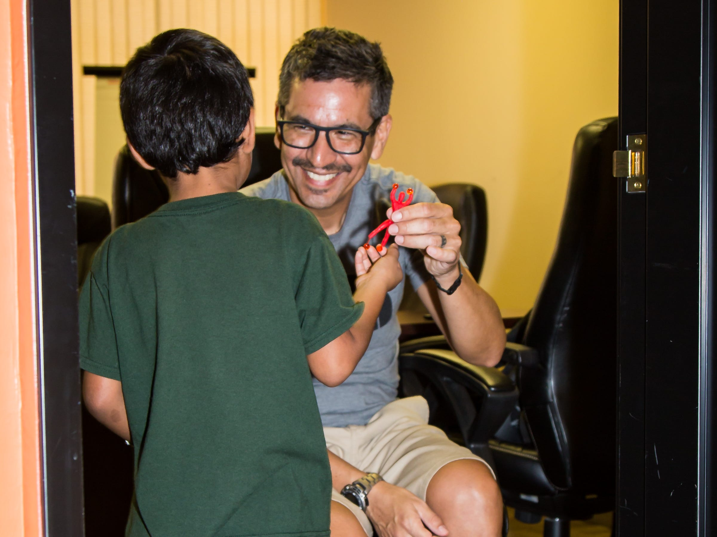 A pastor helps a boy in Phoenix.