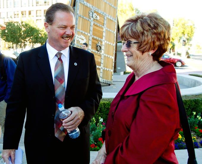 Scottsdale Mayor Jim Lane talks with Phoenix Vice Mayor Thelda Williams at a P.F. Chang's Rock 'N' Roll Marathon and Half-Marathon event in Scottsdale on  Jan. 13, 2011.