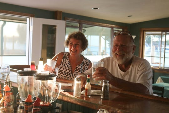 Judy and Jerry Sacco, of Alliance, enjoy an evening at Bootleggers Waterfront Grille and Bar in downtown Port Clinton.
