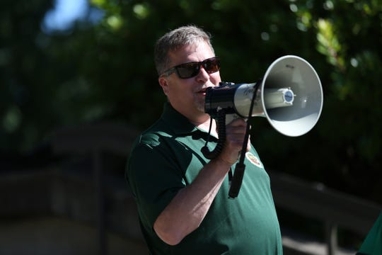 Matthew Starbuck, the American Federation of State, County and Municipal Employees Local 2067 President, speaks during a rally for updating contract negotiations for city of Salem employees outside City Hall on Thursday, July 19, 2018.