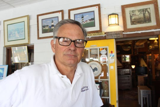 George Cole at his antiques shop in Bethany Beach.
