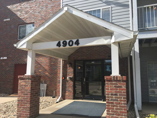 The front door to the Sioux Falls, South Dakota, apartment complex that is home to Paul Erickson, who is linked to Maria Butina, facing federal charges of being a Russian agent.