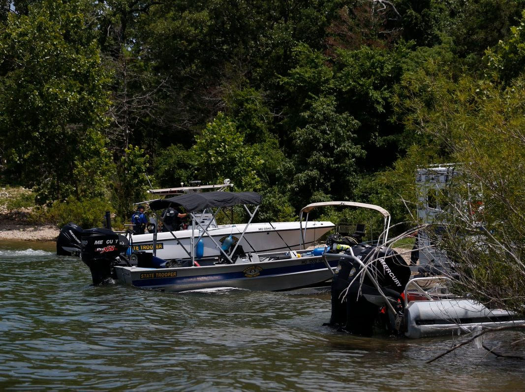 Dive boats and equipment used in the search for victims Friday on Table Rock Lake after the capsizing of a Ride the Ducks boat on Thursday night during high winds.