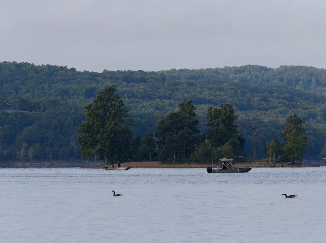 Rescue boats searched Table Rock Lake on Friday where the Ride the Ducks boat sank Thursday.