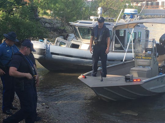 There are nine Missouri State Highway Patrol divers in the water at Table Rock Lake as part of the search team. They can hear communications from the boats and possibly communicate to each other while underwater.