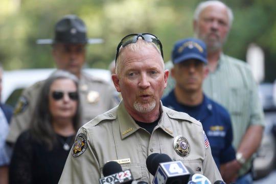 Stone County Sheriff Doug Rader speaks to the media Friday morning.
