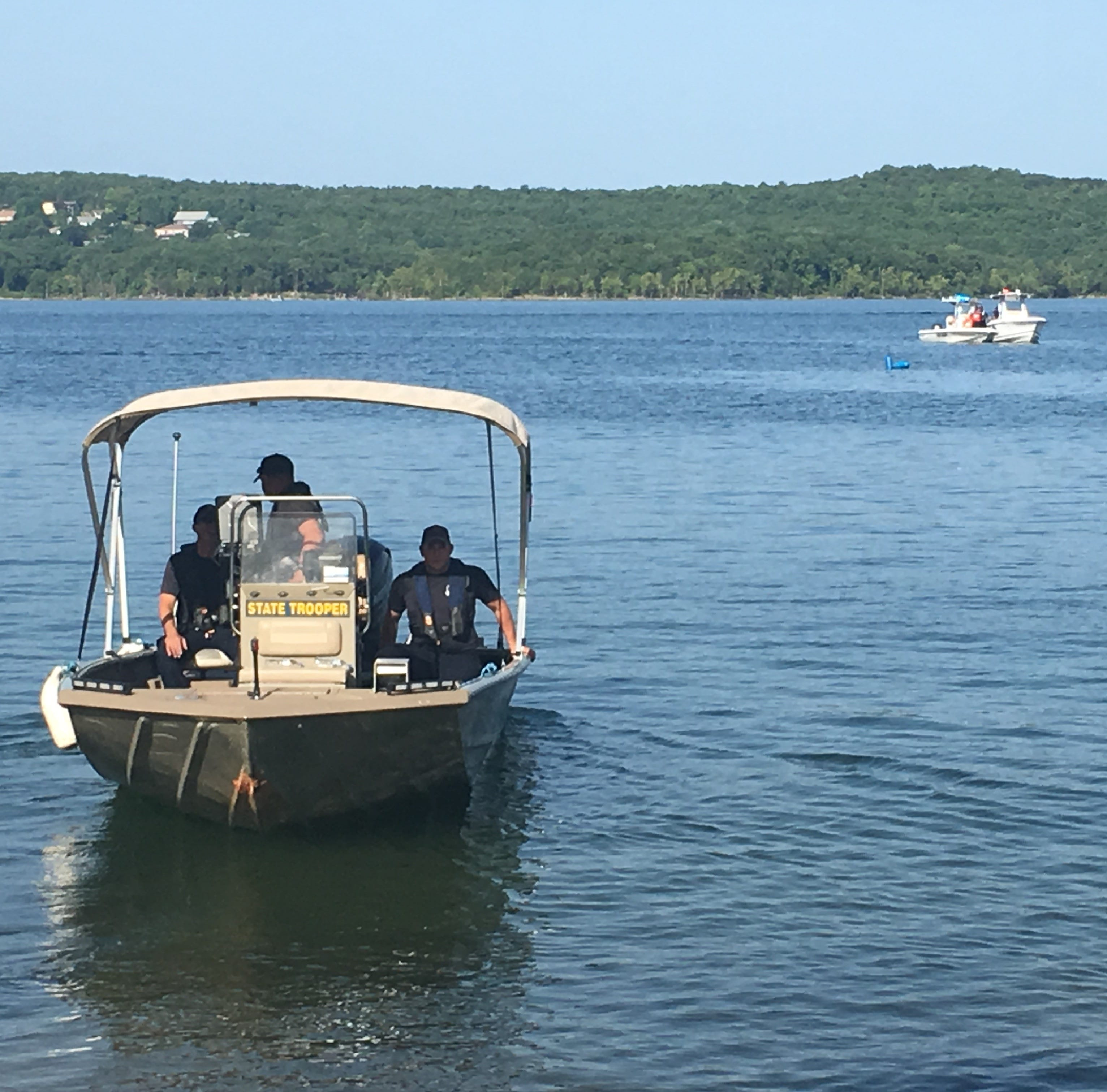 Divers find duck boat on bottom in 80 feet of murky water