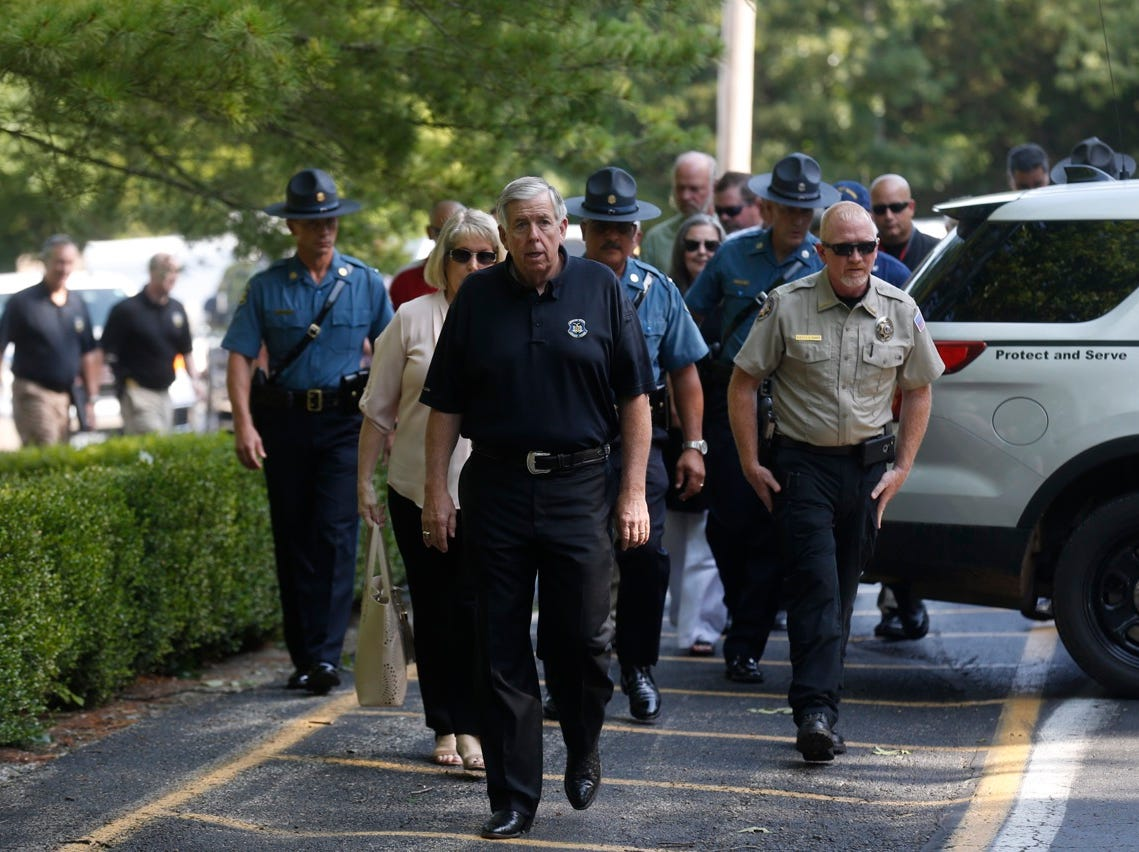 Gov. Mike Parson arrives in Branson on Friday morning before giving a statement on the Ride the Ducks tragedy.