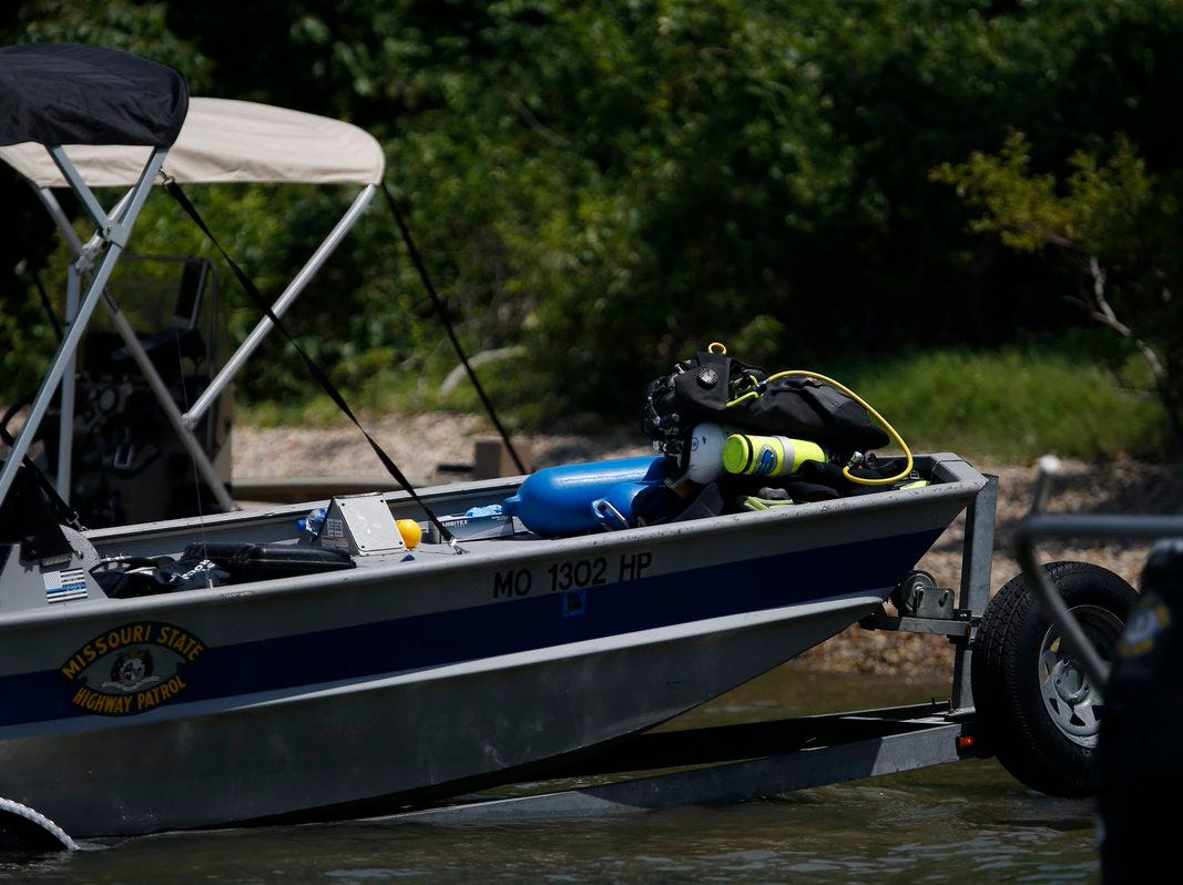 Dive boats and equipment used in the search for victims Friday on Table Rock Lake after the capsizing of a Ride the Ducks boat on Thursday night during high winds
