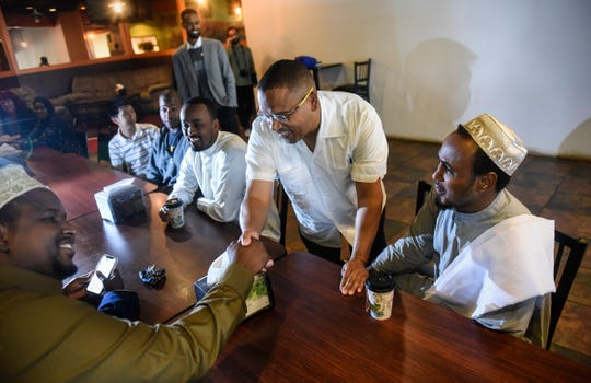 U.S. Rep. Keith Ellison greets people before a meeting in which he discussed his campaign for the state attorney general's office  Friday, July 20, in St. Cloud.