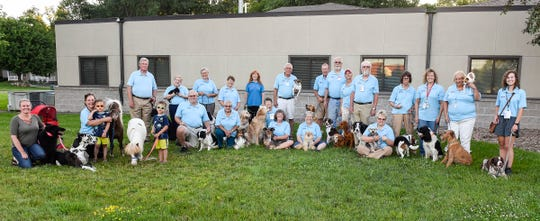 Members of the Central Minnesota Therapy Animal Association gather for a group photo with their certified therapy pets Tuesday, July 17, during their monthly meeting at St. John's Episcopal Church