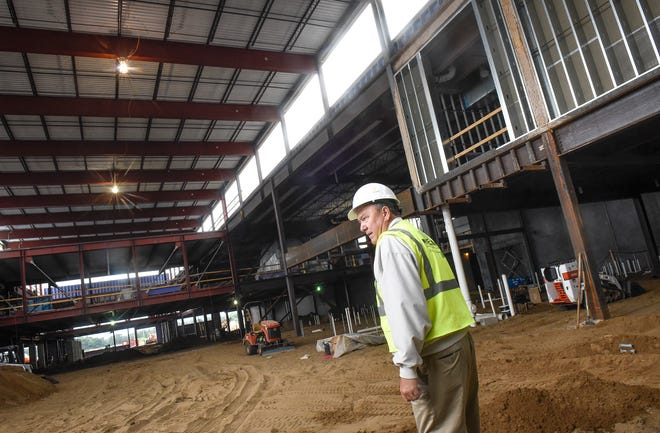District superintendent Jeff Schwiebert walks through the commons area Thursday, July 19, at the new Sartell High School construction site.