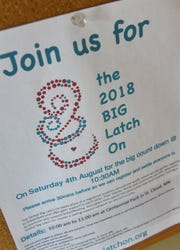 A sign announcing the the Big Latch On, a worldwide event to promote breastfeeding and its health benefits, is on display at For All of Maternity in St. Cloud.