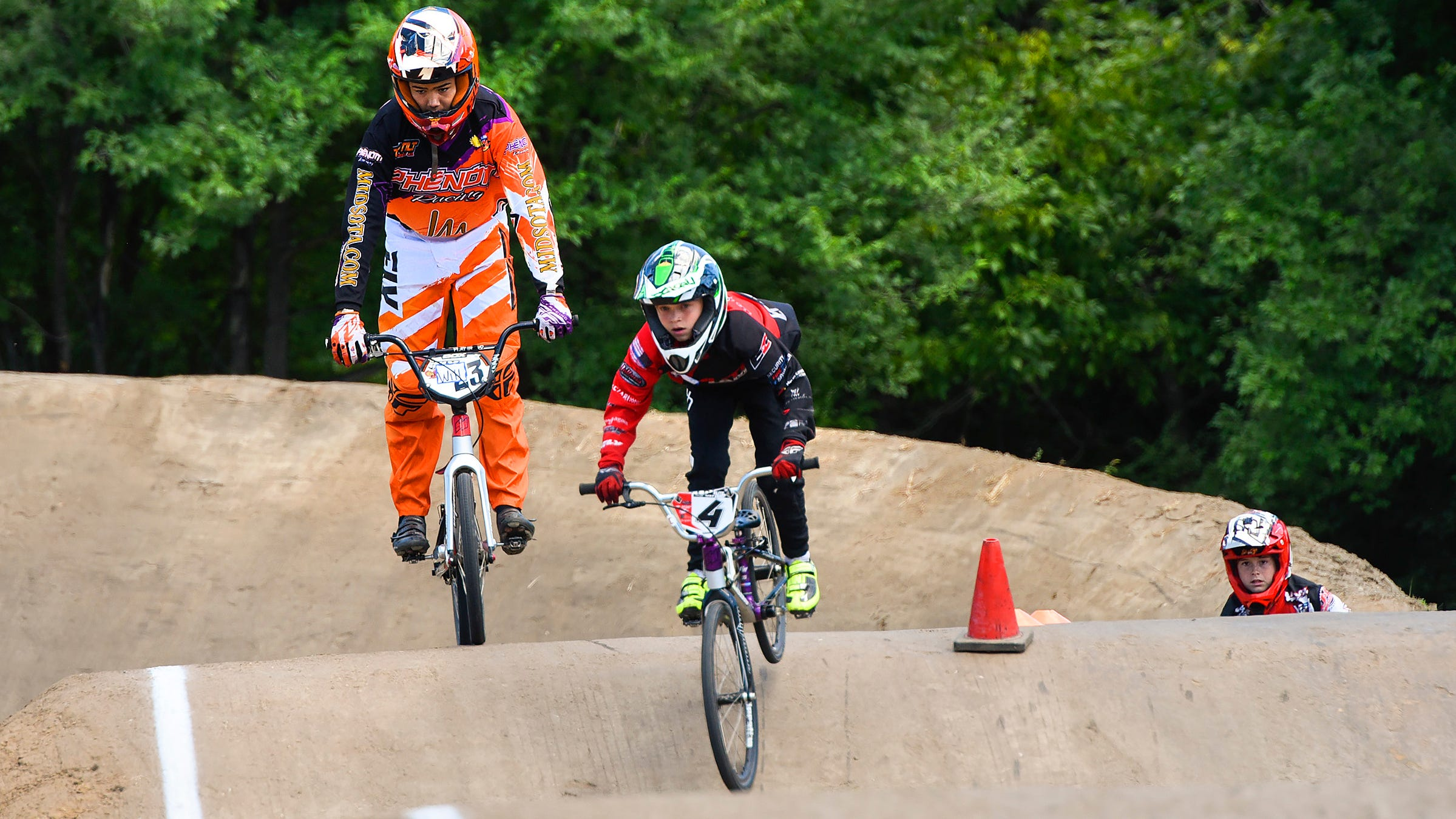 Riders work on their skills during the Sam and Alise Willoughby clinic Tuesday, July 17, at Pineview Park BMX.
