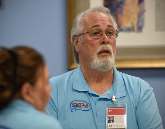 J.P. Martin, Royalton, started the Central Minnesota Therapy Animal Association. He joins other members at the monthly          meeting Tuesday, July 17, at St.  John's Episcopal Church