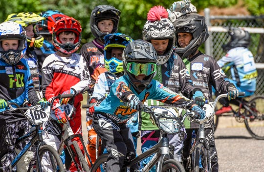 Riders take turns riding an obstacle course for Sam Willoughby Tuesday, July 17, during a clinic at Pineview Park BMX.