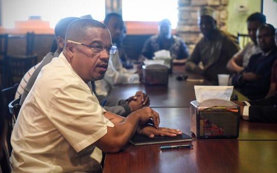 U.S. Rep. Keith Ellison outlines his reasons for running for Minnesota attorney general during a meeting with residents Friday, July 20, in St. Cloud.