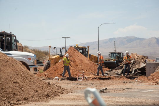 Construction crews work at the intersection of Bluff Street and Sunset Boulevard Wednesday, July 18, 2018.