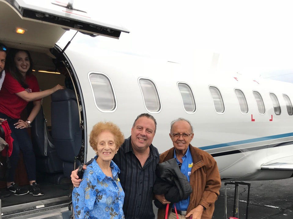 Diana, Marcos, and Daniel Luis Flores and Freddie the dog with their charter flight out Puerto Rico.