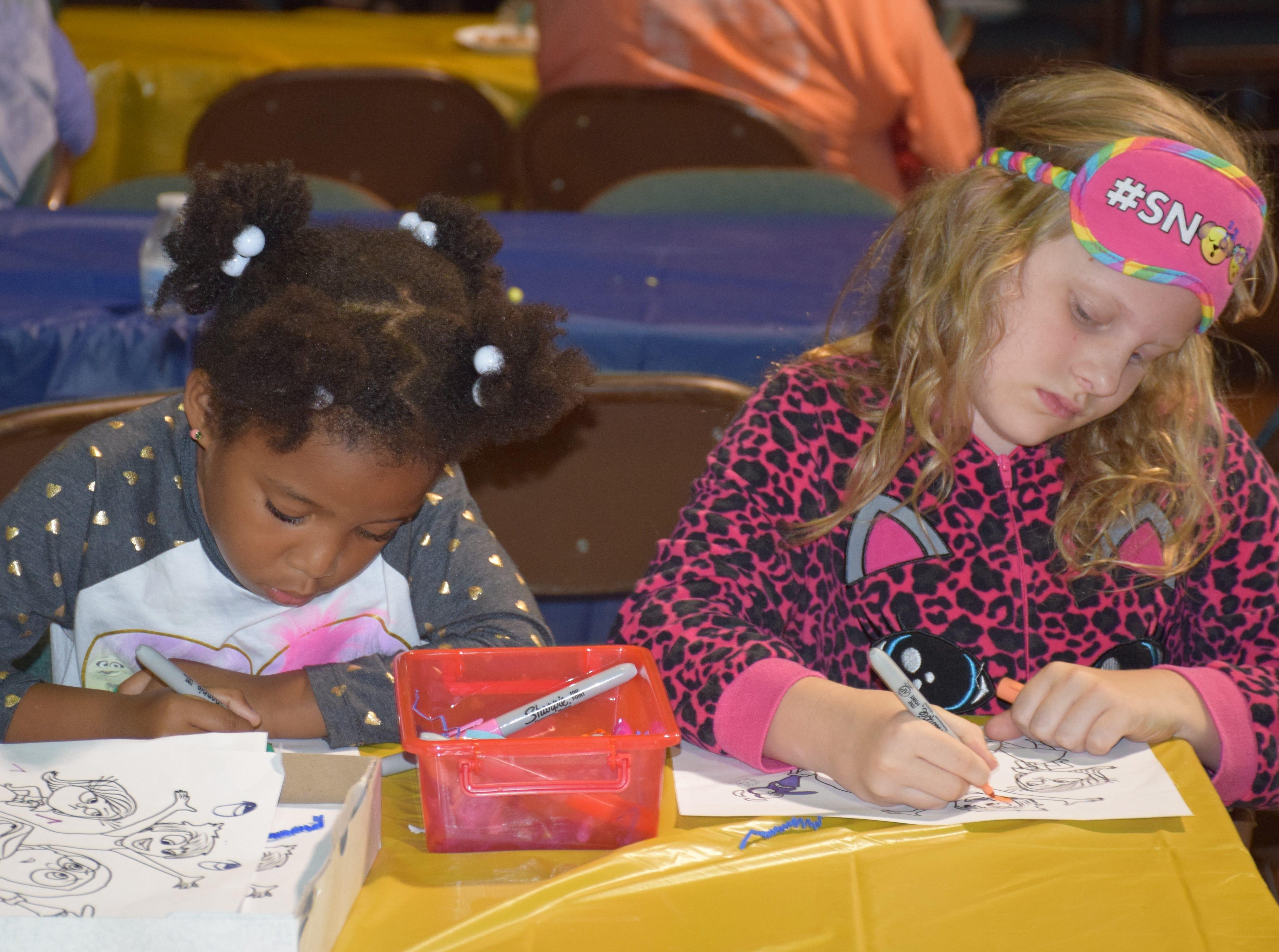 Coreyanah, 5, and Payton, 8, enjoy the arts and crafts.
