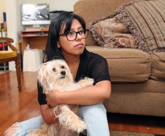 Teresa Alvarado, 17, with their family dog Julie photographed at their Garnerville home on Friday, July 20, 2018.  Julie was reported missing in July of 2017 and was found and returned after a year missing.