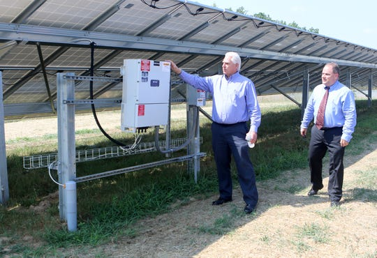 Delaware Municipal Electric Corporation (DEMEC) president and CEO Patrick McCullar and Smyrna town manager Gary Stulir tour the Smyrna Solar Facility, which will deliver 1.5 megawatts of electric energy to residents and businesses in the town.