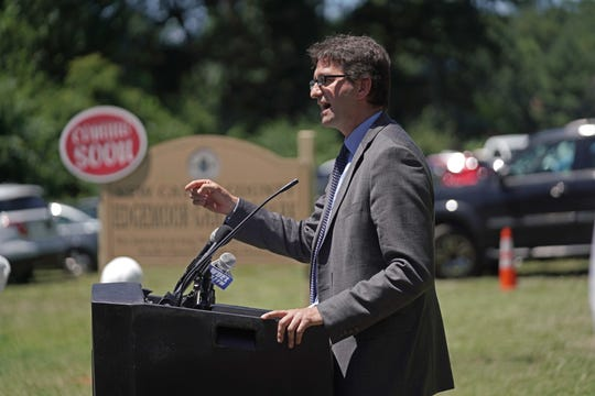 New Castle County executive Matt Myer speaks at a groundbreaking ceremony for the new Edgemoor Gardens Park that will  feature a basketball court, playground and paved perimeter walking trail.
