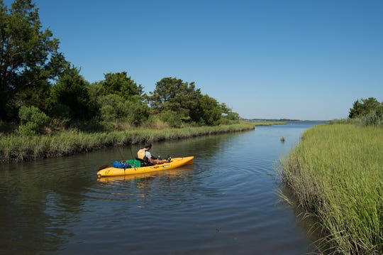 A kayaker with his kayak on the Rehoboth Bay.