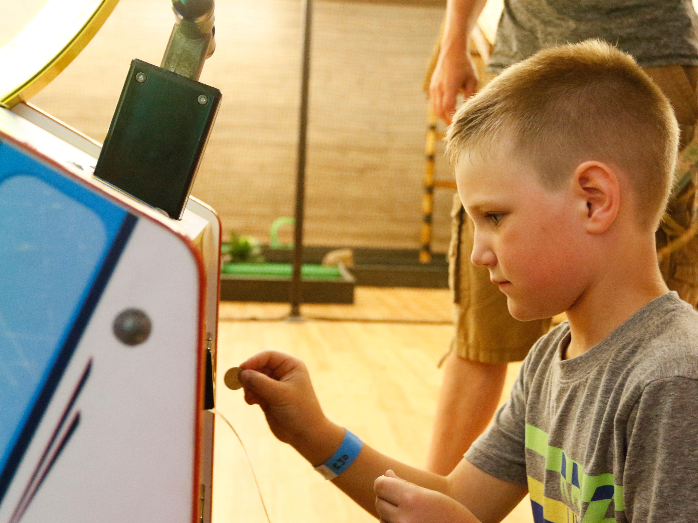 Layton Kramer, 8, plays a game at Hub City Adventure Wednesday, July 18, 2018.