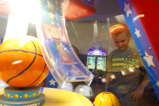 Layton Kramer, 8, plays a game at Hub City Adventure Wednesday, July 18, 2018.