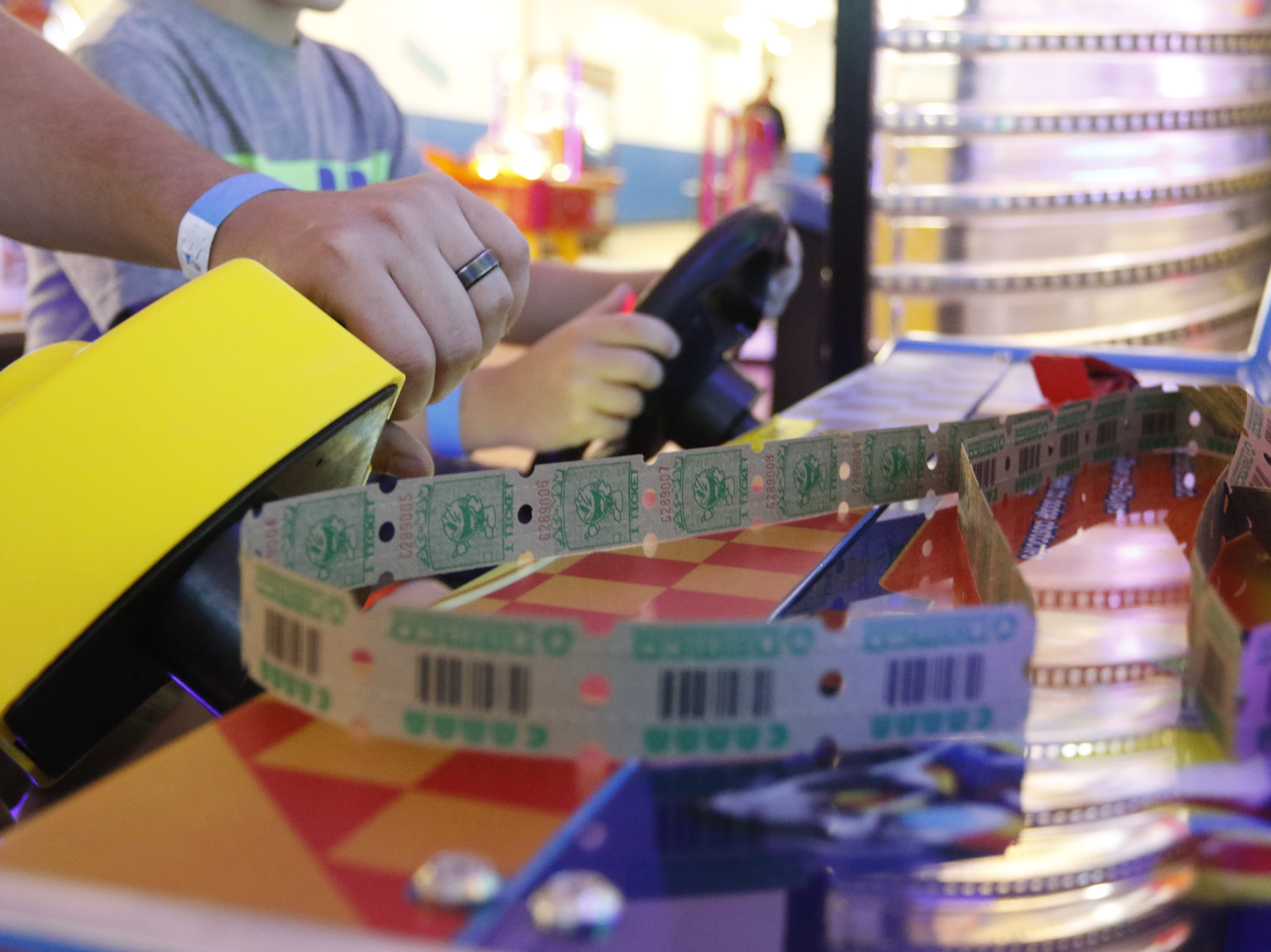 Layton Kramer, 8, and his father Chris Matijevic plays a game at Hub City Adventure Wednesday, July 18, 2018.