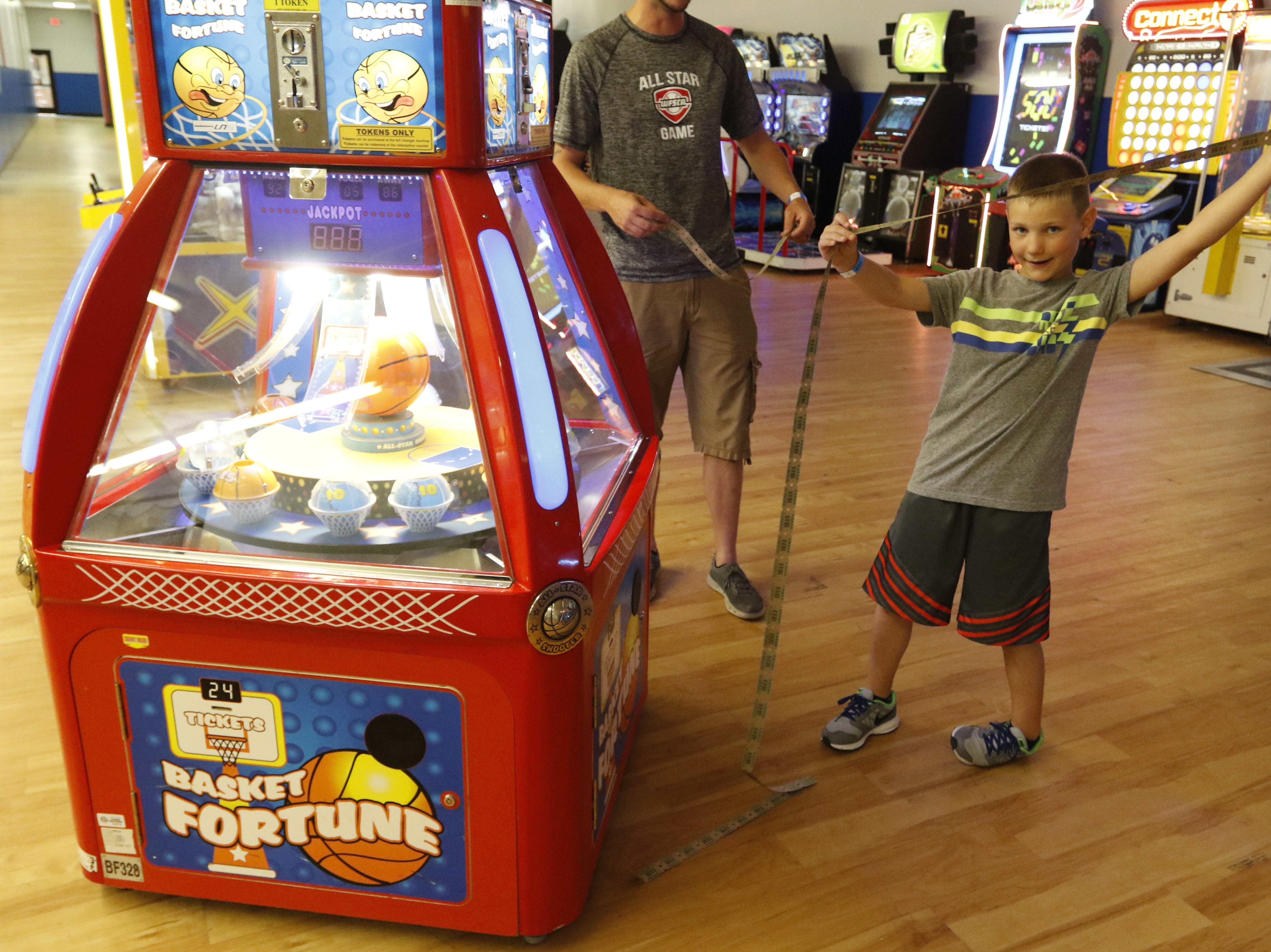Layton Kramer, 8, holds up his tickets at Hub City Adventure Wednesday, July 18, 2018.