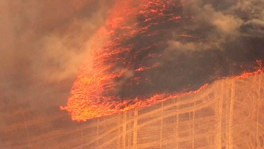 This image made from video provided by FOX 12 News shows a grassland fire burning near The Dalles, Ore., Wednesday, July 18, 2018. The fast-moving deadly fire fueled by gusting winds in the Pacific Northwest forced dozens of households to evacuate and prompted Oregon Gov. Kate Brown to declare a state of emergency Wednesday.