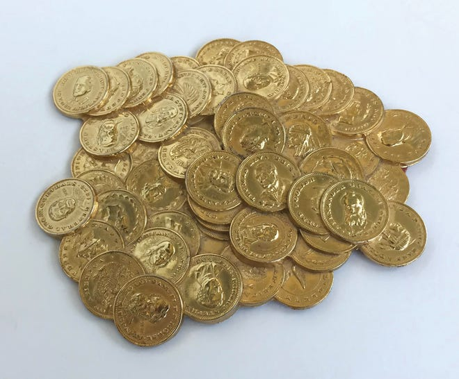 This 5 1/2-inch wide pile of coins is a paperweight, probably first made in the 1960s. It was a popular gift for good customers and executives who were in financial businesses. Some are being sold online for about $40 to $50.