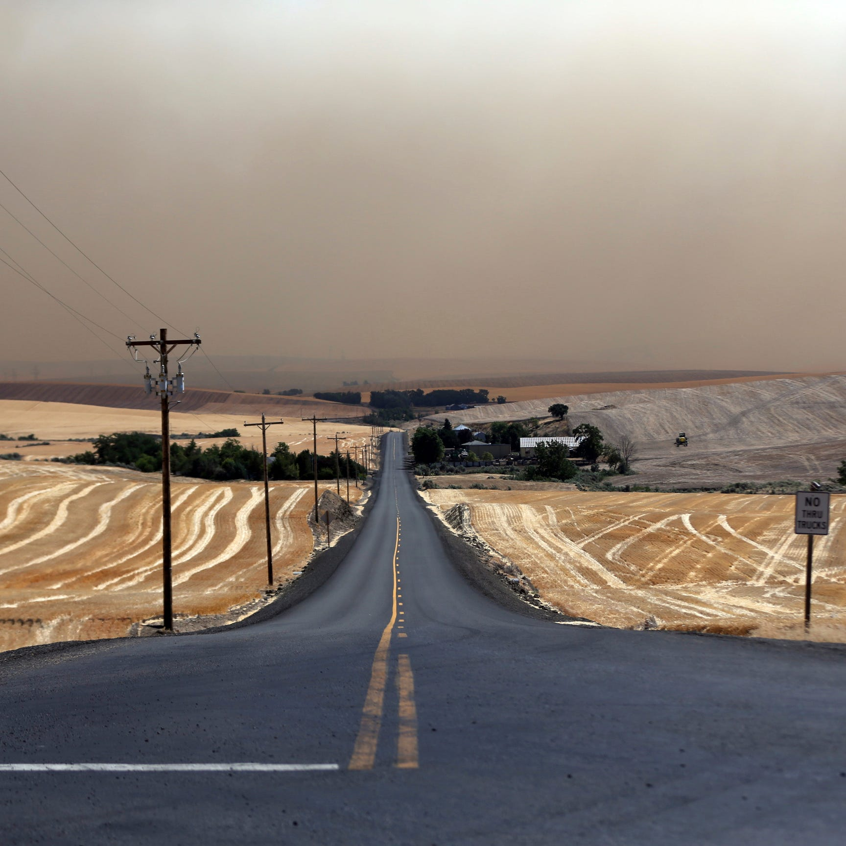 Oregon wheat farmers try to stop fire that's consuming crops