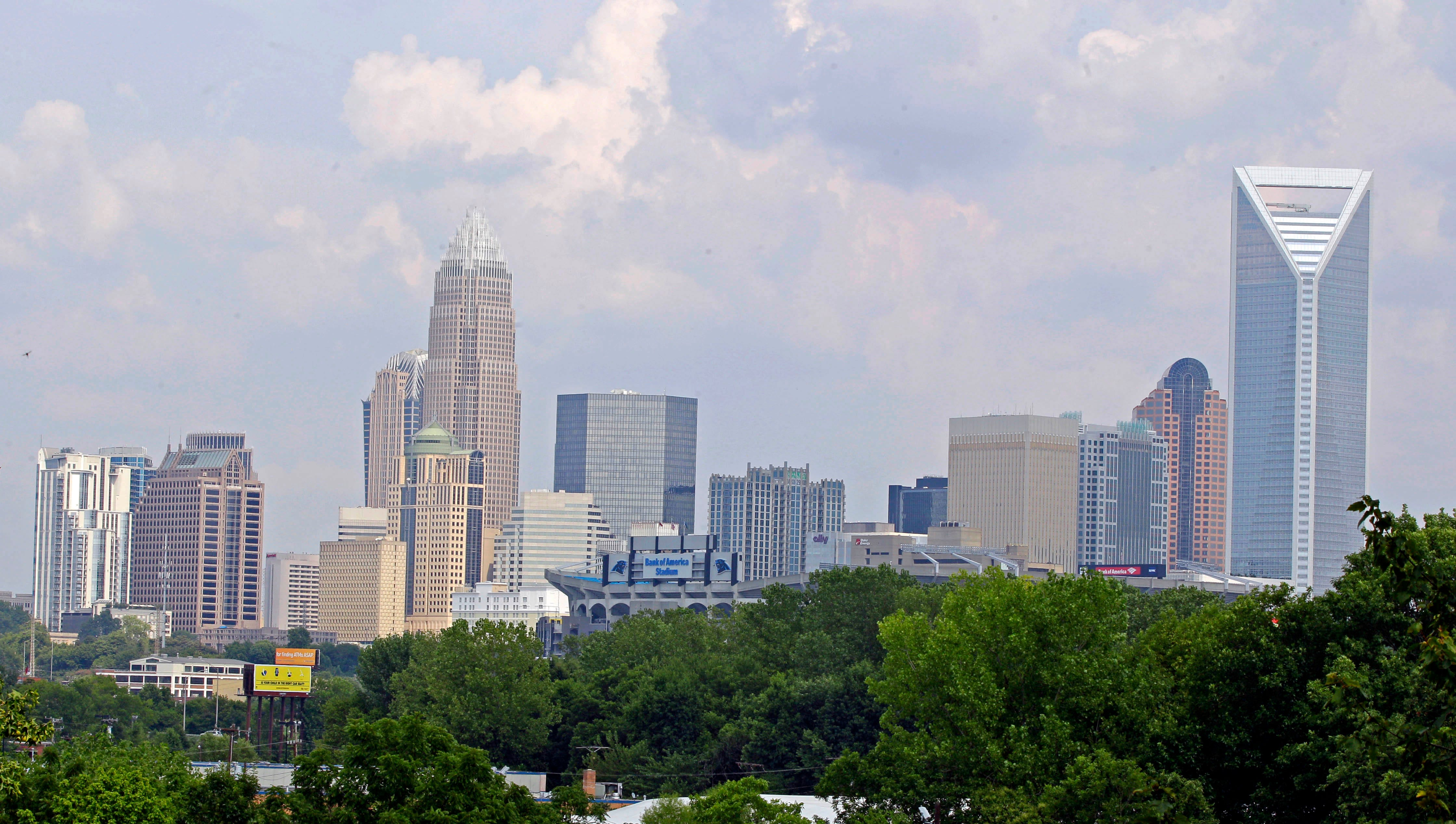 In this July 17, 2012 photo the skyline of Charlotte, N.C., is shown. Much was made about Charlotte emerging on the big stage when Democrats awarded their 2012 national convention to the city last year. But the tidy city of gleaming skyscrapers built with money during the flush years of banking is more in its middle age, trying to reinvent itself without cutting all the ties to its big cash past. (AP Photo/Chuck Burton) ORG XMIT: NCCB202