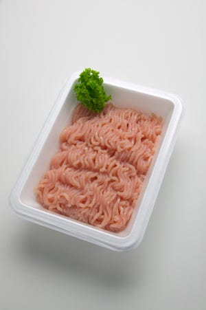 A package of uncooked ground turkey.