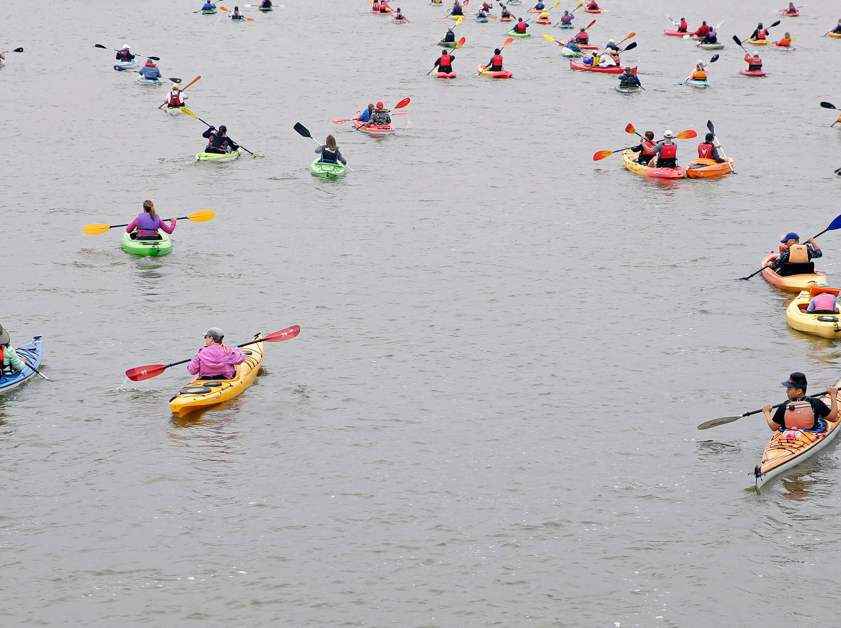 The Park-to-Park Paddle takes place Saturday, July 21, 2018, as paddlers make their way from Neenah to Appleton, Wis.
