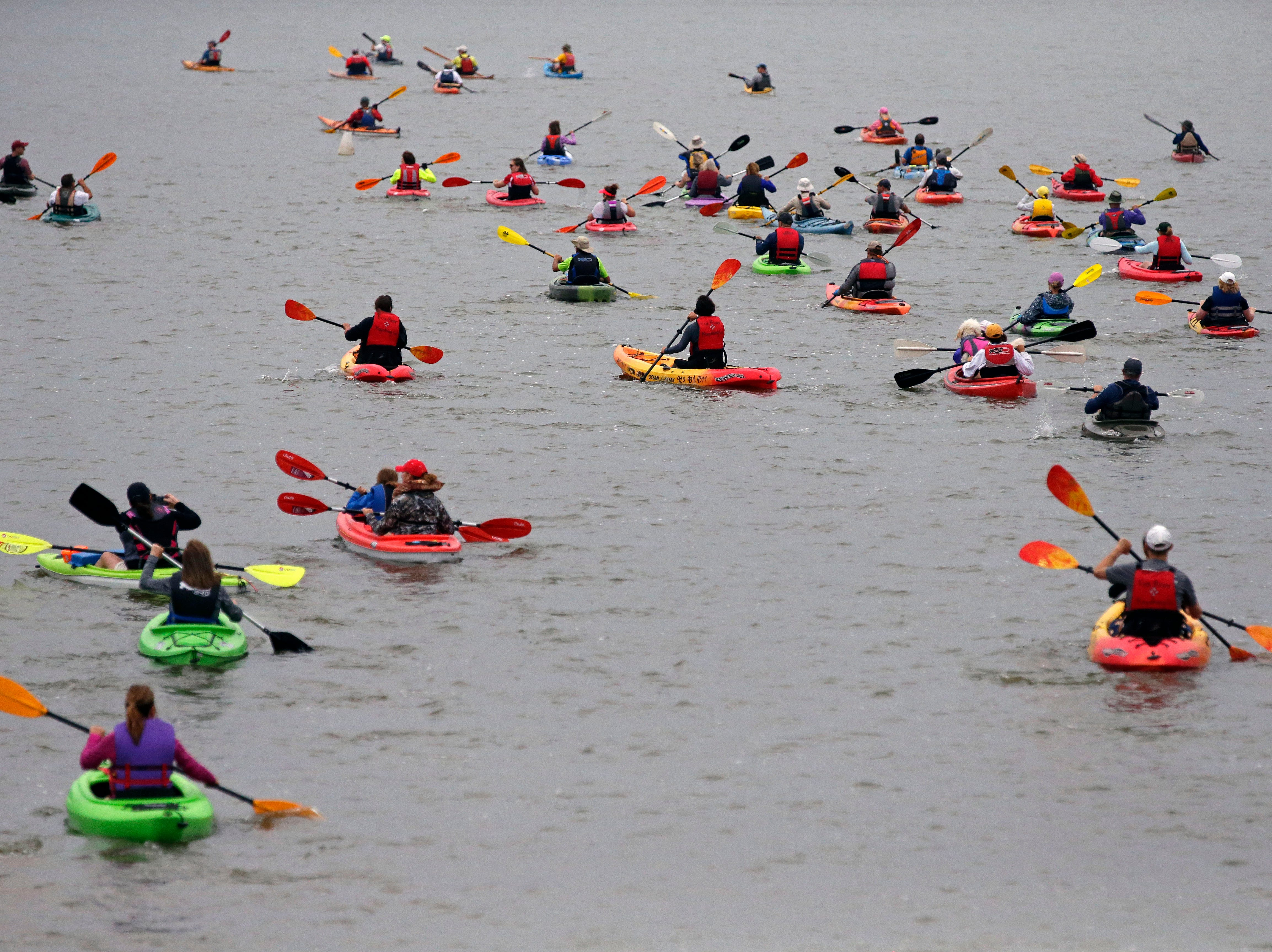 The Park-to-Park Paddle gets underway Saturday, July 21, 2018, as paddlers make their way from Neenah to Appleton, Wis.