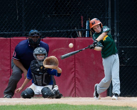 Middletown Little League's James Finer hits the winning 6th inning home run in finals game against Brick in the Little League Section 3 Final.