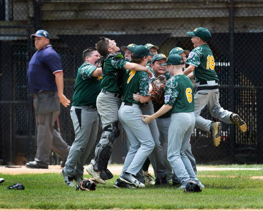 Middletown celebrates its Little League Section 3 Finals win against Brick.