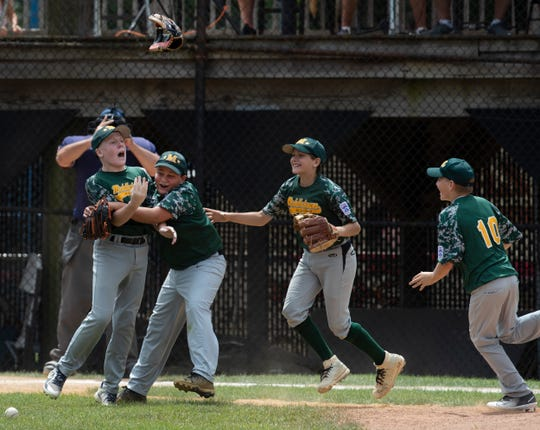 Middletown Little League celebrate its Section 3 Finals win against Brick.